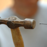 Hammering nail into wood