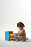 Baby playing, wearing re-usable nappy