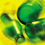 Close up of green bottles on yellow background