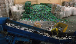 Conveyor belt at Materials Recycling Facility with bales of plastic bottles