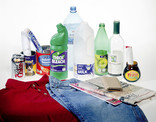 Assorted recyclables - plastic bottles, metal cans, cardboard, glass and clothing