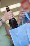 Woman packing bottles in re-usable bottle bag