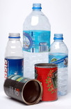 Assorted plastic drinks bottles and metal food tins