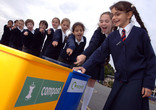 School children recycling in the playground