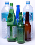 Plastic water bottles and green, blue and brown glass bottles