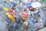 Pile of crushed plastic bottles, tubs and trays for recycling