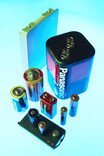 Assorted household batteries on blue background