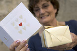 Woman with greetings card and wrapped present