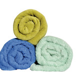 Blue and green rolled up towels