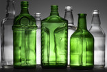 Alternate clear and green glass bottles