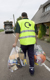Clear recycling sacks being collected for recycling near cottage