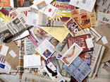 Pile of mail with leaflets, magazines and newspapers