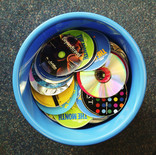 Bin full of used CDs and discs