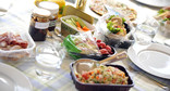 Picnic food in re-used plastic containers and jars