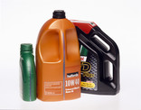 3 plastic motor oil bottles