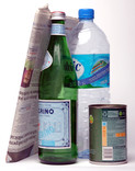 Newspaper, green glass bottle, food tin, plastic water bottle
