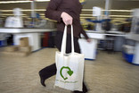 Woman with re-usable fabric shopping bag in supermarket