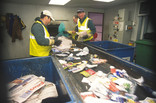 Sorting recycling on conveyor belt at a Materials Recycling Facility (MRF)