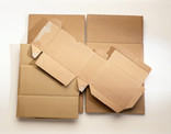 Pile of flattened plain corrugated cardboard boxes