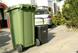 Green wheelie bin and food waste caddy