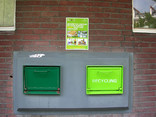 Recycling point on street built into wall