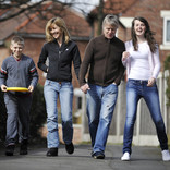 Parents and teenage children walking