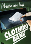 Close up of putting carrier bag of clothes into clothing bank