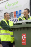Recycling crew with plastic bottles wheelie bin