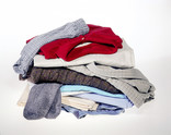 Messy pile of men's clothes