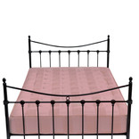 Bed with metal frame and purple mattress