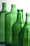 Four green glass bottles