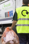 Orange recycling sacks being collected for recycling