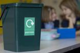 Green waste bin in school canteen