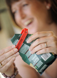 Woman using food clip to reseal a packet