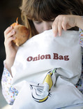 Girl with onion and onion bag