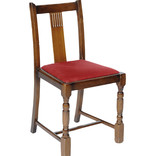Dark wooden chair with covered seat