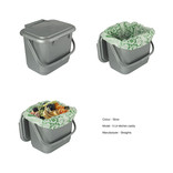 Silver food waste kitchen caddy shown with compostable liner