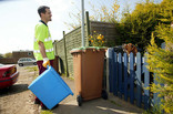 Dog greets member of the recycling collection crew
