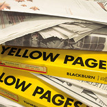 Pile of newspapers and Yellow Pages catalogues
