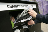 Donating clothes at a charity clothing bank