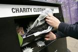 Donating clothes at a charity clothing bank