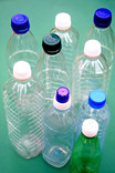 Assorted plastic water bottles with lids