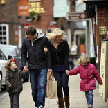 Young family in town shopping - re-usable shopping bag