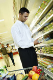 Man choosing ready meals in supermarket