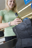 Woman packing bottles in re-usable bag