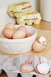 Whole eggs and egg shells in egg box
