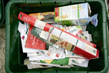 Green recycling bin full of paper and cardboard