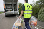Clear recycling sacks being collected for recycling at back of lorry