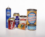 Assorted metal packaging in a row - aerosol, drinks cans, food tins
