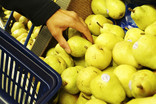 Choosing pears in supermarket